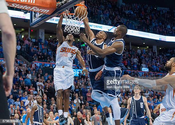 Phoenix Suns Guard Brandon Knight [3043] goes up for a dunk while Oklahoma City Thunder Guard Russell Westbrook [1973] and Oklahoma City Thunder...