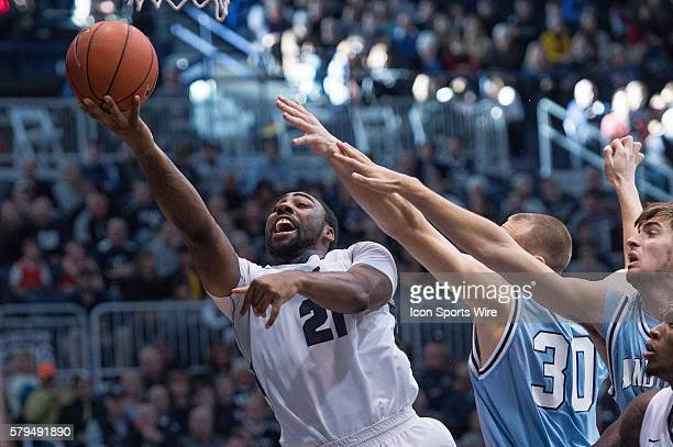 Butler University guard Roosevelt Jones drives by Indiana State Sycamores forward Matt Van Scyoc during the NCAA basketball game between the Butler...