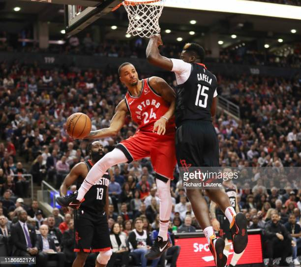 December 5 In the first half, Toronto Raptors guard Norman Powell makes a pass around Houston Rockets center Clint Capela under the Rockets hoop. The...