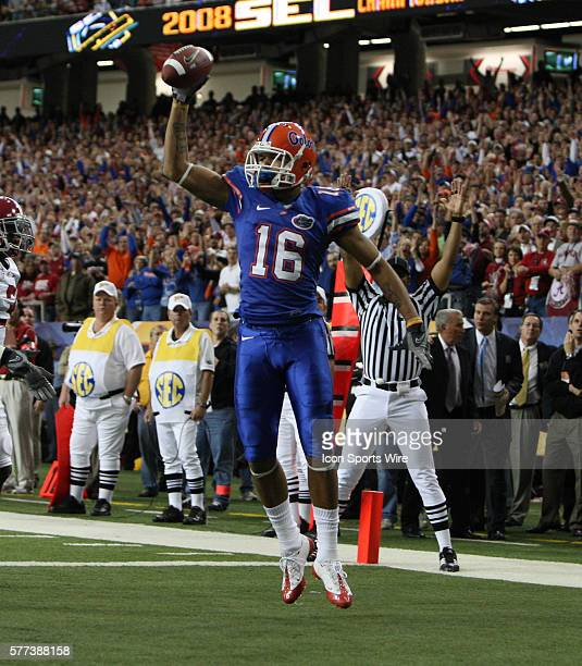Florida wide receiver Carl Moore celebrates after a 3 yard touchdown reception in the first quarter of the SEC Championship game at the Georgia Dome...