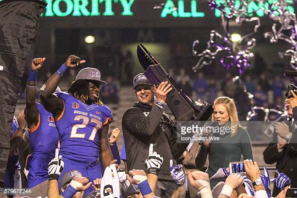 Boise State Broncos head coach Bryan Harsin hoists the championship trophy at the conclusion of the Mountain West Conference Championship game...