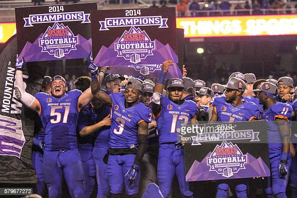 Boise State Broncos offensive lineman Tennessee Su'esu'e celebrates with other Boise State teammates after the Mountain West Conference Championship...