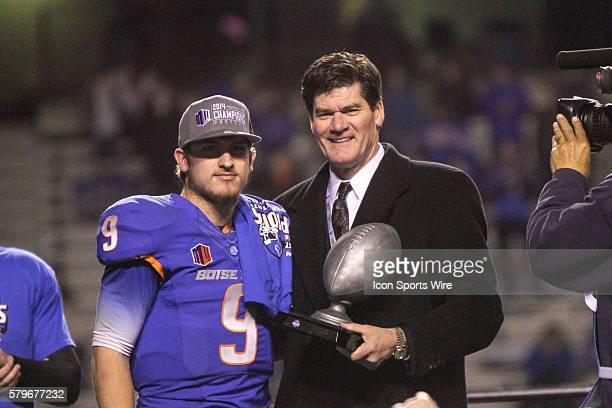 Boise State Broncos quarterback Grant Hedrick Offensive MVP and commissioner Craig Thompson after the conclusion of the Mountain West Conference...
