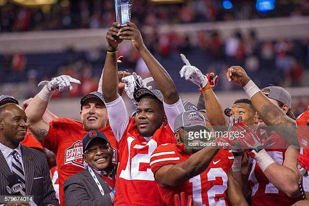 Ohio State Buckeyes quarterback Cardale Jones holds the Big Ten Championship trophy after the NCAA Big 10 Championship football game between the...