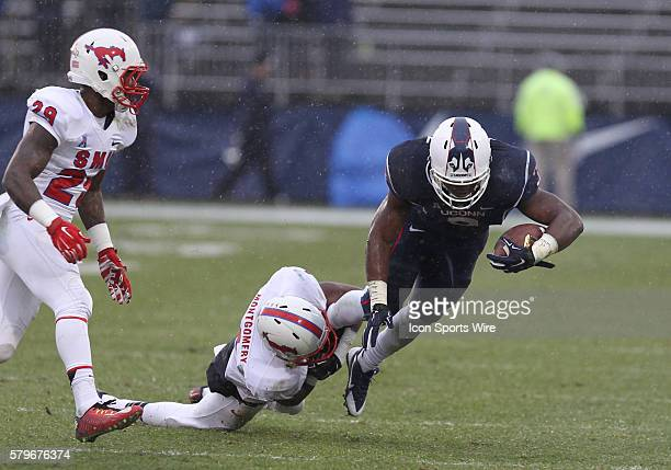 SMU Mustangs Defensive Back Jesse Montgomery tackles Uconn Huskies Running Back Ron Johnson during an American Athletic Conference football game...