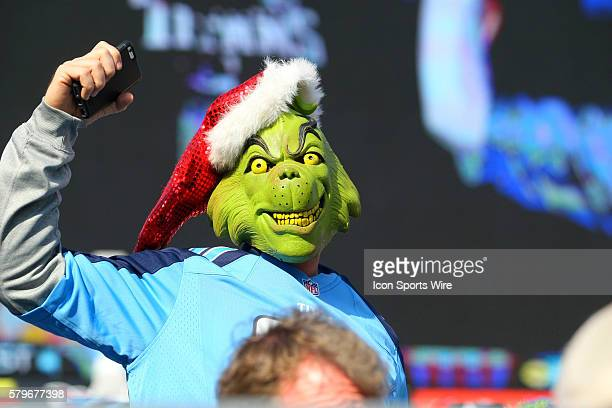 A Tennessee Titans fan is dressed as Dr Suess' Grinch during game action The Giants are leading the Titans 170 during first quarter game action at LP...