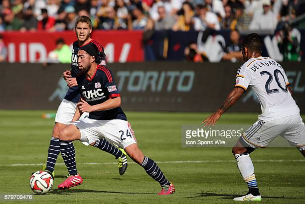 New England Revolution's Lee Nguyen cuts away from Los Angeles Galaxy's AJ DeLaGarza The Los Angeles Galaxy defeated the New England Revolution 21 to...