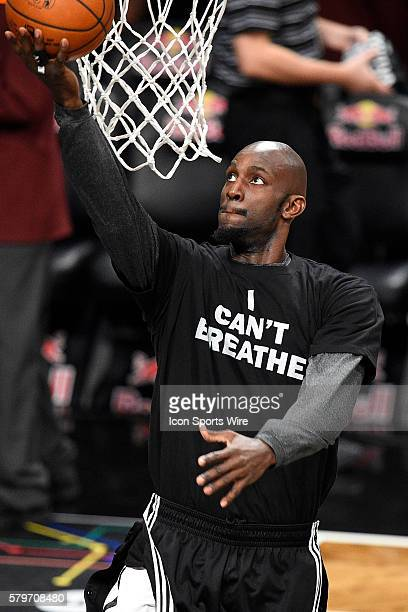 Brooklyn Nets forward Kevin Garnett wears a t shirt to honor Eric Garner during warmups before a NBA game between the Cleveland Cavaliers and the...