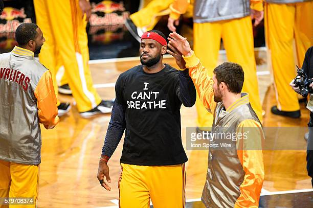 Cleveland Cavaliers forward LeBron James wears a t shirt to honor Eric Garner as the team is introduced during a NBA game between the Cleveland...