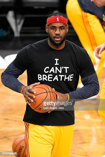 Cleveland Cavaliers forward LeBron James wears a t shirt to honor Eric Garner during warmups before a NBA game between the Cleveland Cavaliers and...