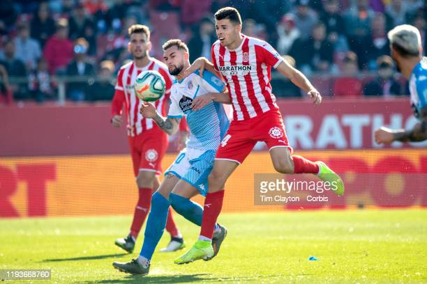 Gerard Gumbau of Girona and Antonio Campillo of Lugo challenge for the ball during the Girona V Lugo La Liga second division regular season match at...