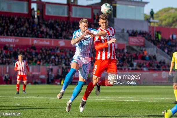 Pedro Alcala of Girona heads goal wards while defended by Antonio Campillo of Lugo during the Girona V Lugo La Liga second division regular season...