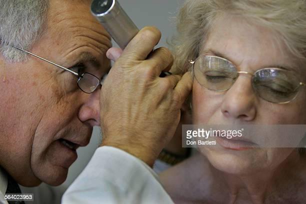 December 9 2005 Mission Viejo Dr Brian Levine examines patient Betty Johnson's ear drum to determine sinus pressure abnormalities Levine just opened...