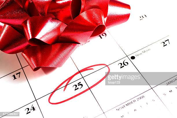 december calendar 25th circled, red gift bow for christmas - countdown stock photos and pictures