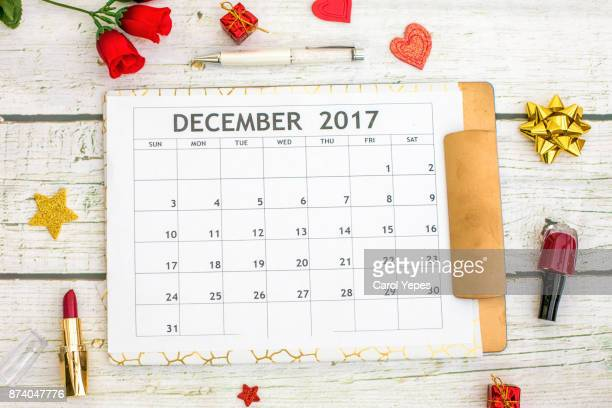 december calendar on desk with roses and cosmetics - december stock pictures, royalty-free photos & images