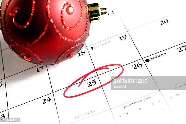 December calendar. Red ornament with 25th circled. Christmas day! Reminder.