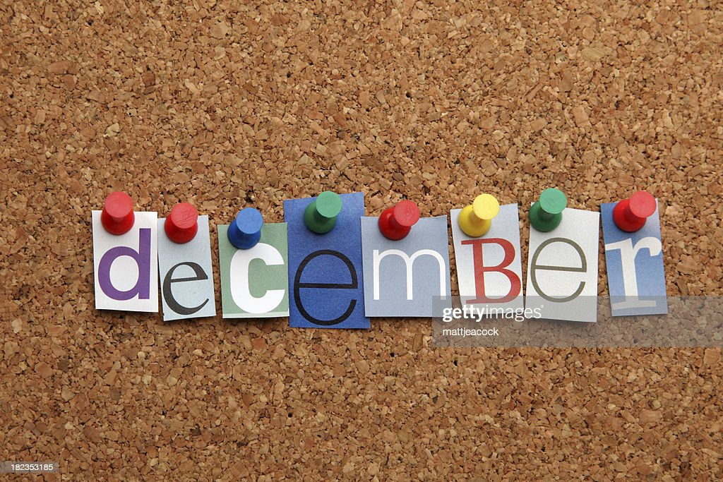 December pinned on noticeboard : Stock Photo