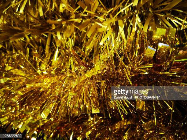 december the 4th, 2018. christmas golden tinsel - tinsel stock pictures, royalty-free photos & images