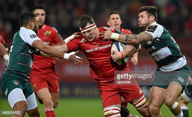12 December2015 Robin Copeland Munster is tackled by Adam Thompstone left and Telusa Veainu Leicester Tigers European Rugby Champions Cup Pool 4...