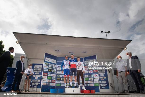 Deceunick Quick-Step winner Remi Cavagna poses on the podium next to second-place Groupama FDJ Rudy Molard and third-placed AG2R CITROEN Damien Touze...