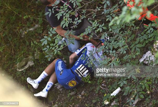 Deceuninck - Quick Step Belgium rider Remco Evenepoel lies down after crashed during the 114th edition of the giro di Lombardia , a 231 km cycling...