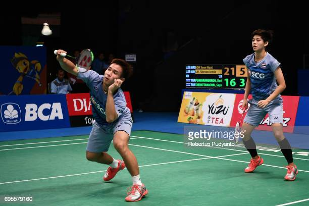 Dechapol Puavaranukroh and Sapsiree Taerattanachai of Thailand compete against Goh Soon Huat and Shevon Jemie Lai of Malaysia during Mixed Doubles...
