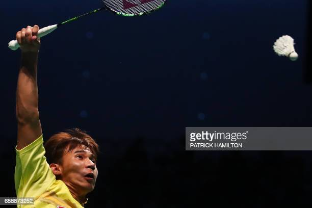 TOPSHOT Dechapol Puavaranukroh of Thailand hits a return during the men's doubles Sudirman Cup match with partner Bodin Issara against Seung Jae Seo...