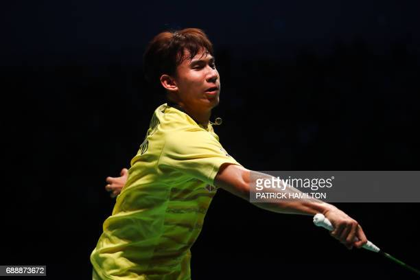 Dechapol Puavaranukroh of Thailand hits a return during the men's doubles Sudirman Cup match with Bodin Issara against Seung Jae Seo and Choi Solgyu...