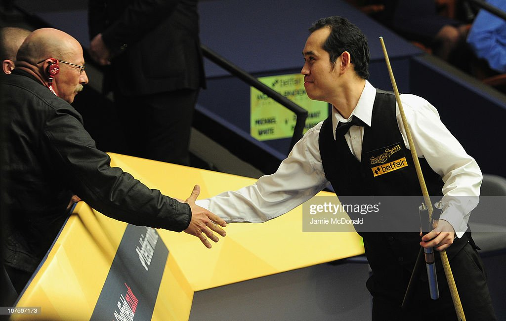 Dechawat Poomjaeng says goodbye to the Crucible after his second round defeat against Miichael White during the Betfair World Snooker Championship at the Crucible Theatre on April 26, 2013 in Sheffield, England.