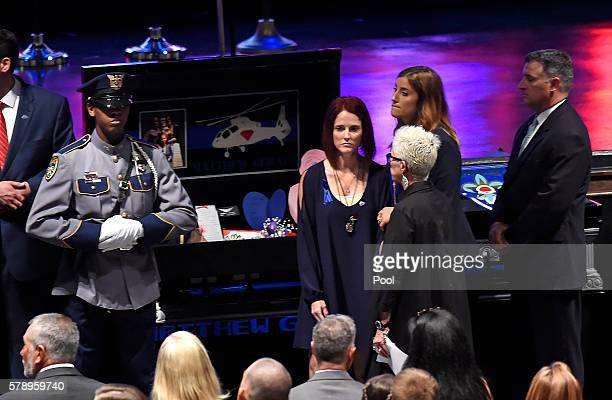 Dechia Gerald wife of slain Baton Rouge police officer Matthew Gerald stands in front of his casket during funeral services at the Healing Place...