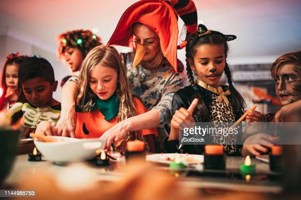 deciding what to eat - halloween kids stock photos and pictures