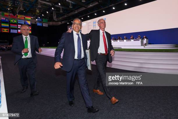 Decio De Maria Carlos Cordeiro and Steven Reed walk off the stage after winning the FIFA World Cup 2026 bid during the 68th FIFA Congress at...