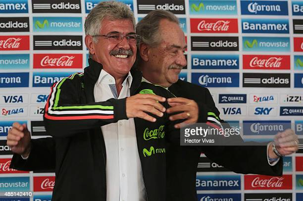 Decio de Maria president of FEMEXFUT helps Ricardo Ferretti head coach of Mexico to wear a Mexico's national team jacket during a press conference to...