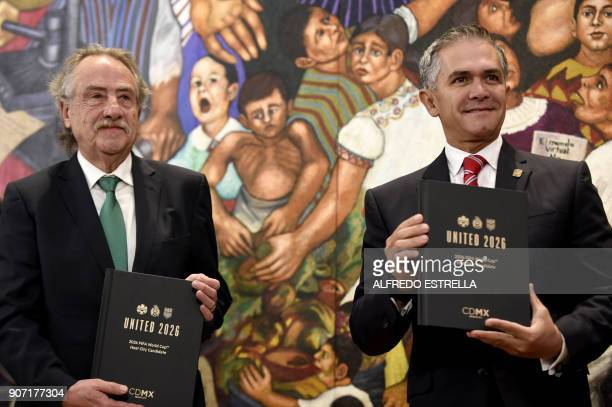 Decio de Maria president of the Mexican Football Federation and Mexico City Mayor Miguel Angel Mancera pose during the presentation of the joint bid...