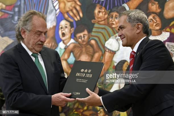 Decio de Maria president of the Mexican Football Federation hands the documents to Mexico City Mayor Miguel Angel Mancera for the joint bid for the...