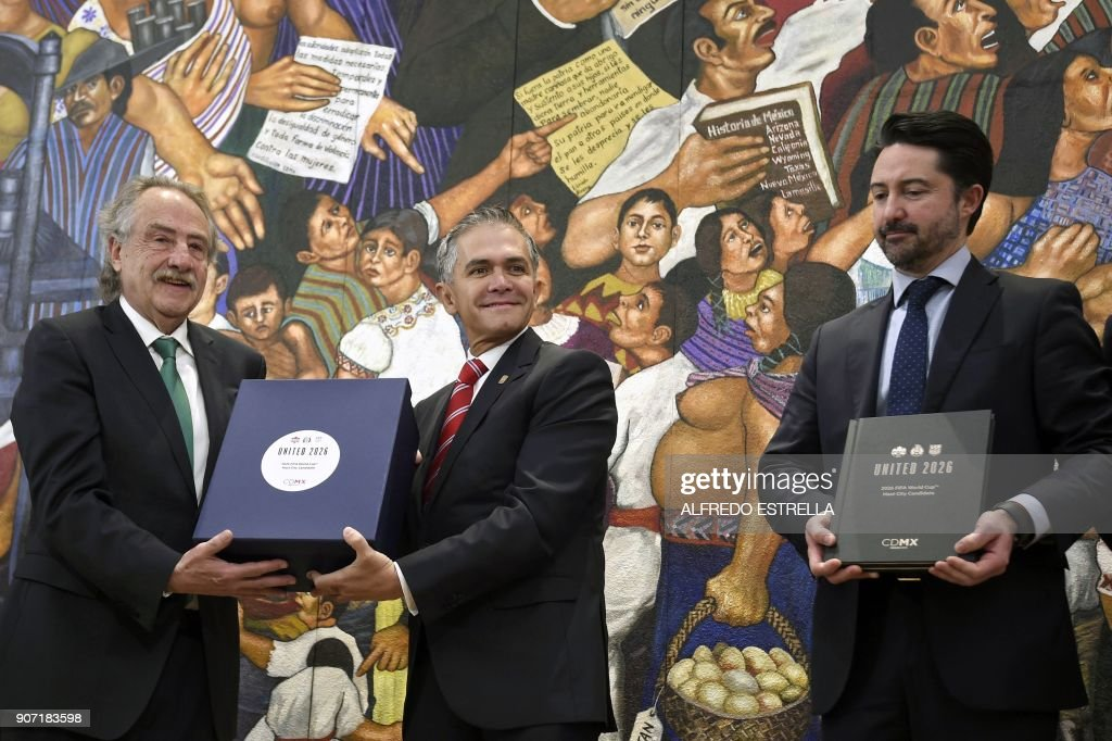 Decio de Maria (L), president of the Mexican Football Federation, Mexico City Mayor Miguel Angel Mancera (C), and Yon de Luisa (R), director of the joint bid for the next soccer 2026 World Cup in North America, pose for photographers in Mexico City on January 19, 2018. The United States, Mexico and Canada announced a joint bid to stage the 2026 World Cup on Monday, aiming to become the first three-way co-hosts in the history of FIFA's showpiece tournament. /