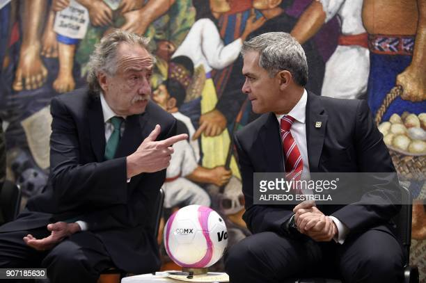 Decio de Maria president of the Mexican Football Federation speaks with Mexico City Mayor Miguel Angel Mancera during the presentation of the joint...