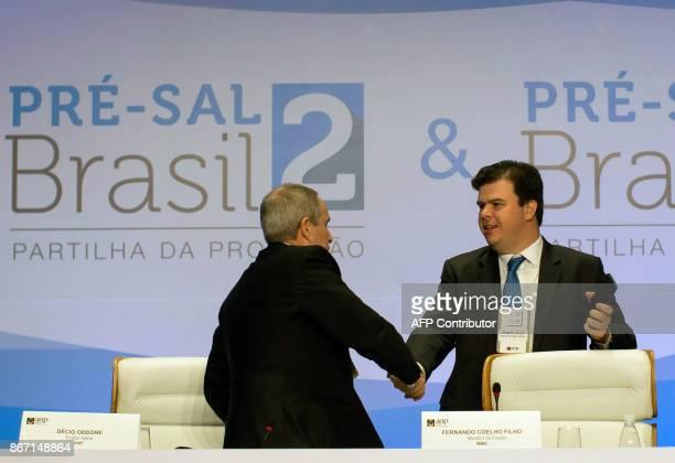Decio Oddone , Director General of the National Petroleum Agency of Brazil and Fernando Coelho Filho Brazilian Minister of Mining and Energy shake...