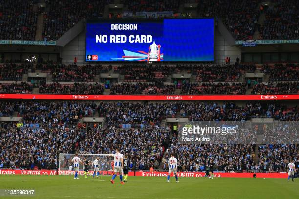 VAR decision is shown on the giant screen during the FA Cup Semi Final match between Manchester City and Brighton and Hove Albion at Wembley Stadium...