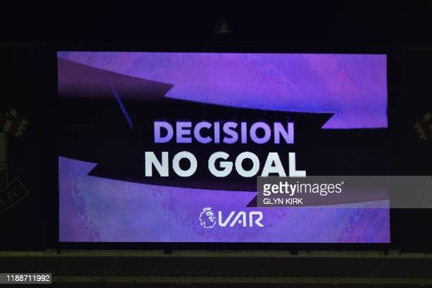 A Decision No Goal message is shown on the scoreboard after a VAR disallowing a goal from West Ham United's English midfielder Michail Antonio during...