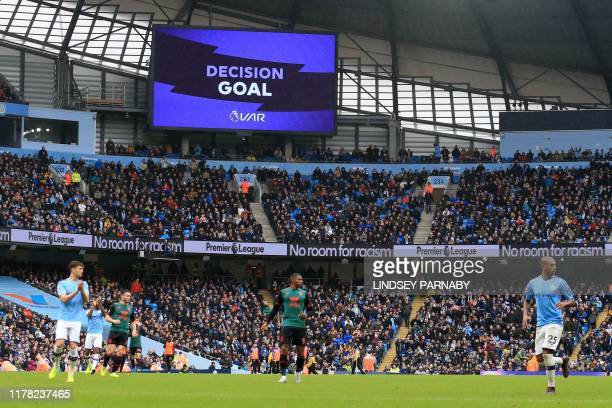 VAR decision on Manchester City's second goal is flashed on the screen during the English Premier League football match between Manchester City and...
