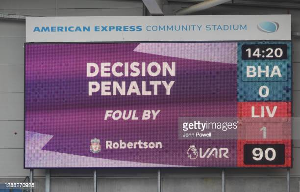 Decision Penalty Foul by Andy Robertson to give Brighton A Penalty during the Premier League match between Brighton & Hove Albion and Liverpool at...