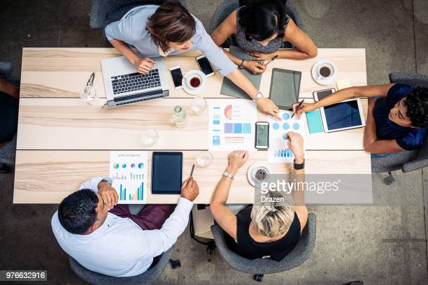 decisions on the business meeting - finance and economy stock pictures, royalty-free photos & images