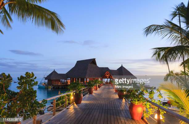 deck and restaurant over tropical ocean, bora bora, french polynesia - tourist resort stock pictures, royalty-free photos & images