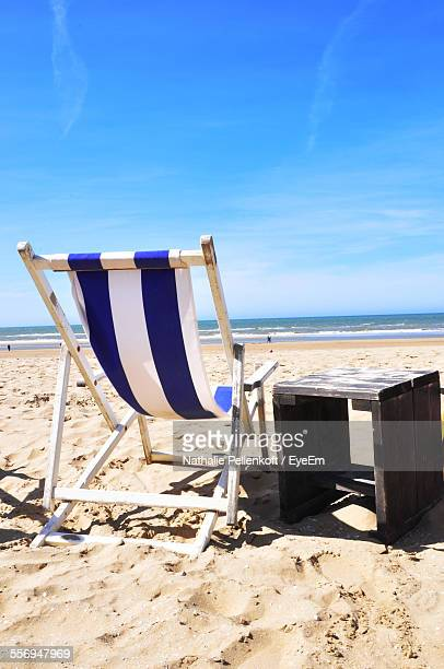 deck chair and table on beach - nathalie pellenkoft stock pictures, royalty-free photos & images