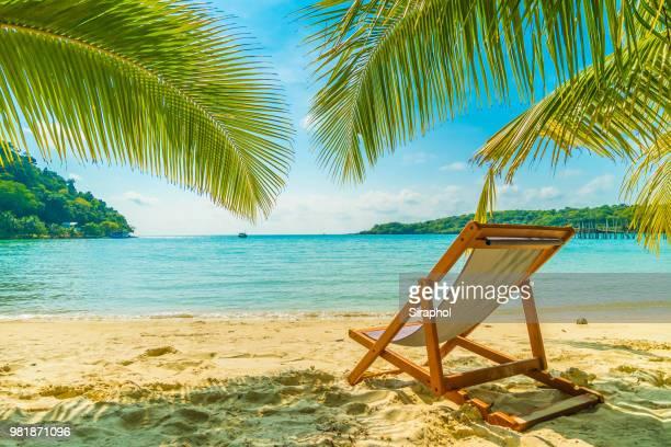Deck Chair At Beach Against Sky