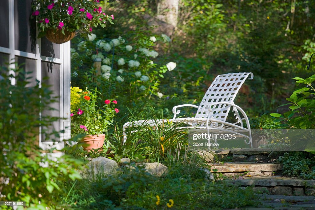 Deck chair in a quiet yard : Stock Photo