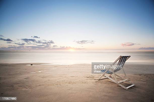 Deck Chair on the Beach at Sunset