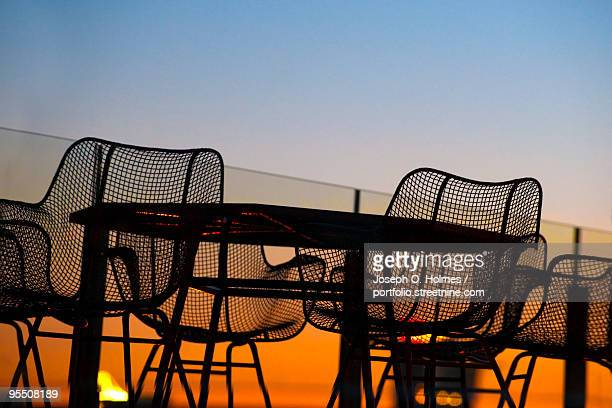 deck chair sunset - joseph o. holmes stock pictures, royalty-free photos & images