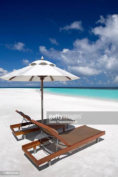 Deck chairs and tropical beach, Maldives, Indian O